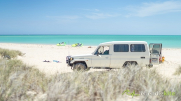 Landcruiser Troopcarrier at the beach and Kites Cabrinha FX Drifter on the secret Kite Spot in Australia