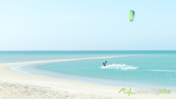 jumping with Kite Cabrinha FX in a shallow flat water lagoon with sand bar in Western Australia