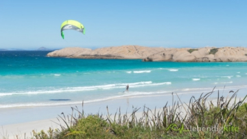 Kitesurfing in Australia on a perfect Kite Spot with white sandy beach and blue water