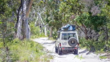 Landcruiser Troopcarrier on a sand track in Australia during the Kitesurfing Trips in Australia