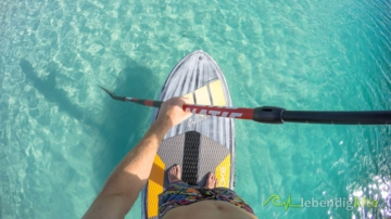 SUP Stand Up Paddle Boarding in Australia on crystal clear water with wave SUP and Fanatic 25 Carbon paddle