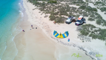 camping directly on the Kitesurfing Spot only accessible with 4x4 drives cars, Cabrinha Contra Kite and Mercedes G Klasse with rooftop tent on the beach