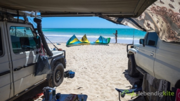Landcruiser Troopcarrier and Mercedes G Class at secret Kitesurfing beach in Australia with awning and Camping